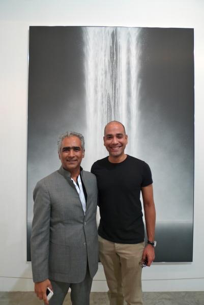 Gallerist Sundaram Tagore (left) in front of work by Hiroshi Senju