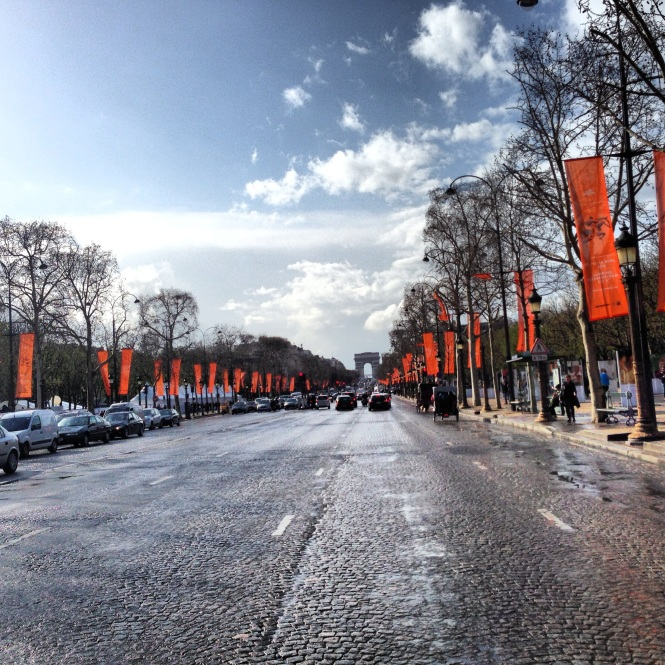 Day 1 and we're welcomed with spring rain and an avenue of fluttering orange Hermes flags