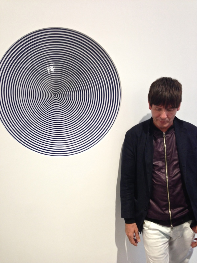 Jim Lambie standing beside 'Vortex (Into the Void)', 2013
