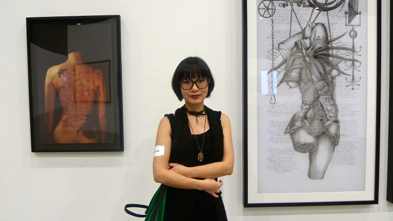 Angela Su in front of her 'Hong Kong Eye' works