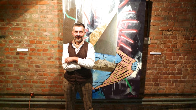 Artist Gosha Ostretsov taking me on a tour of his gallery