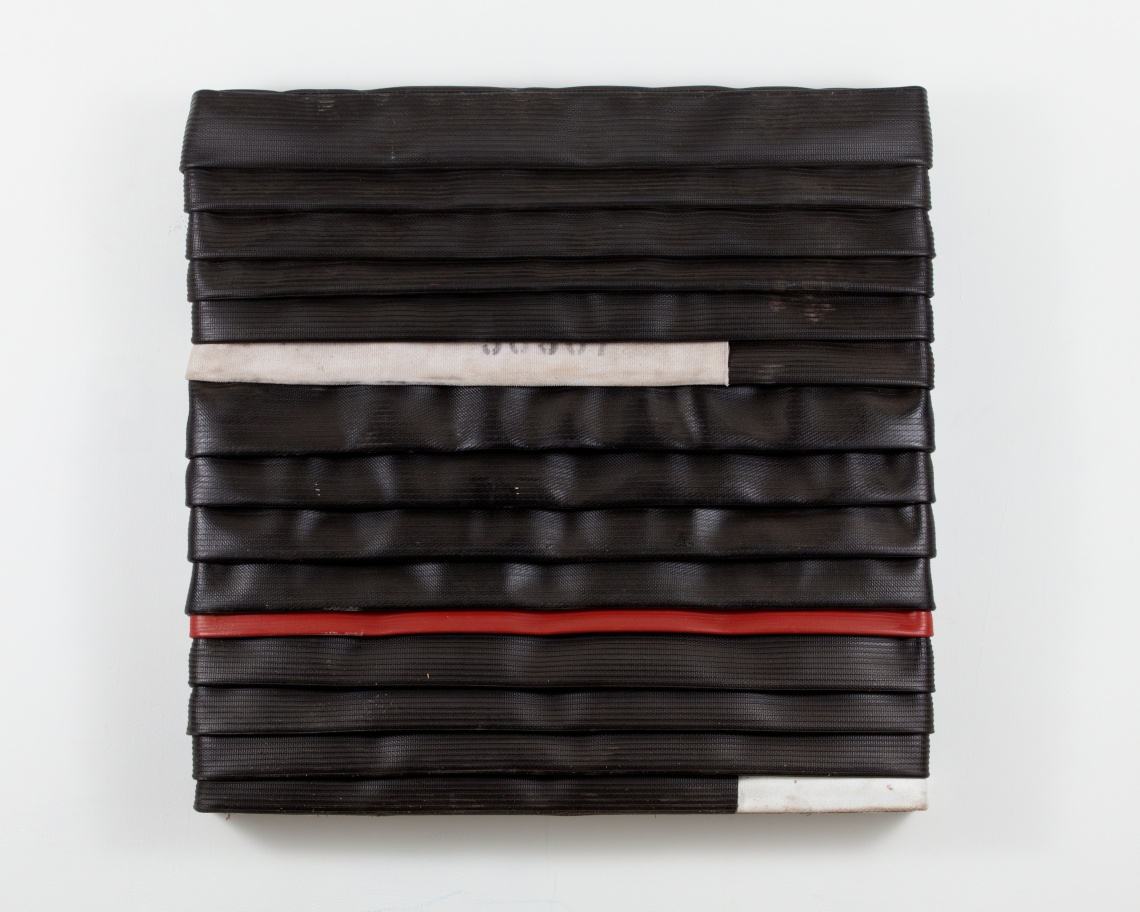 'My Flag', 2013, Wood and decommissioned fire hose. © Theaster Gates. Photo: Sara Pooley. Courtesy White Cube