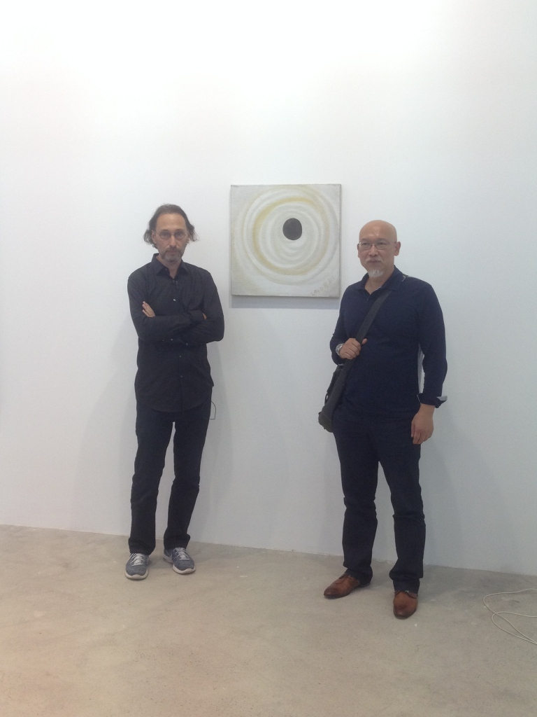 ShanghArt director, Lorenz Helbling (left), and Chinese artist, Zhang Enli (right), at ShanghArt booth