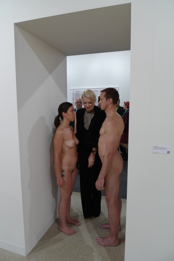 A reenactment of Marina Abramovic's 1977 performance 'Imponderabilia' at Sean Kelly Gallery, Art Basel 2012