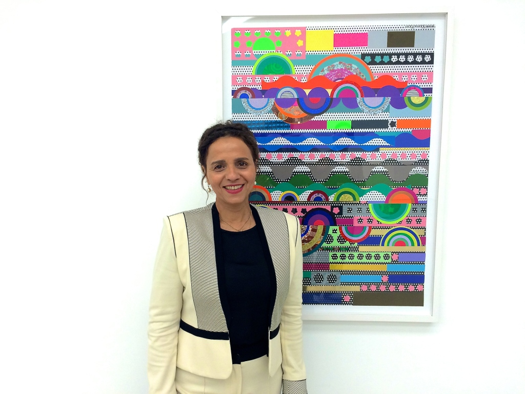 Beatriz Milhazes in front of 'Cake Landscape', 2014, at White Cube Hong Kong