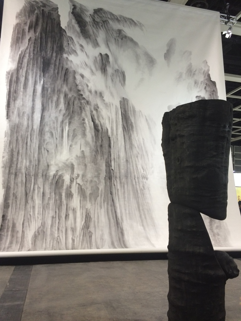 Wang Keping's  'Le Spectateur' (foreground) with Xu Longsen's 'Beholding the Mountain With Awe' ( background) in the Encounters section