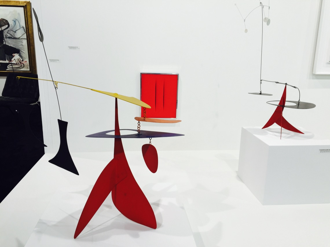 Calder sculptures and a painting by Lucio Fontana, Art Basel.