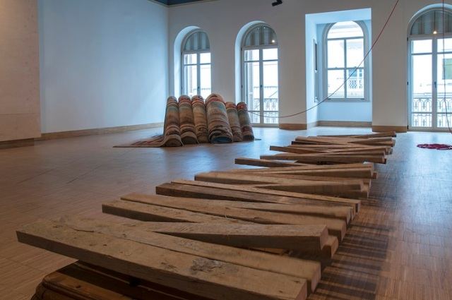 Hera Büyüktaşcıyan, ''Destroy your house, build up a boat,save life!''. Carpet, mechanism,rope,wood. A Century of Centurie', SALT Beyoğlu. Photograph: Mustafa Hazneci