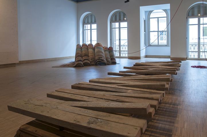 Hera Büyüktaşcıyan, ''Destroy your house, build up a boat,save life!''. Carpet, mechanism,rope,wood. A Century of Centurie', SALT Beyoğlu. Photograph: Mustafa Hazneci